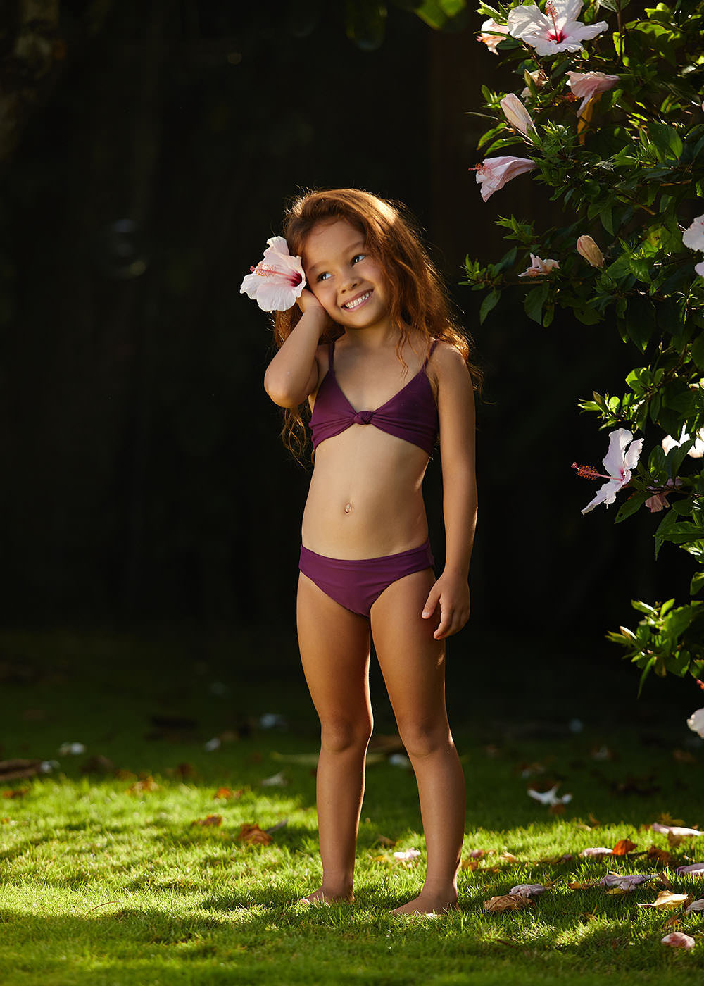 Mikoh Mini wearing the Bella Top and Makapuu Bottom